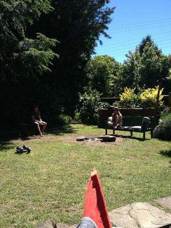 Paradise Pucon International Hostel: Yard and fire pit, plus a parrilla