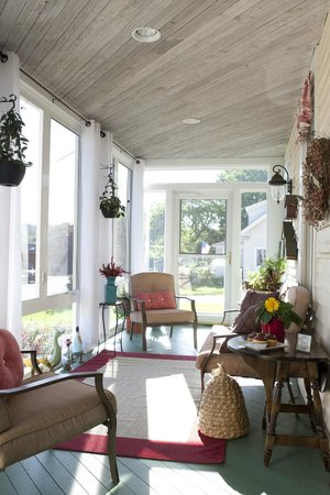 Clark Point Inn: Our 3-season sun room sure makes a great spot for relaxing or reading on a rainy day!
