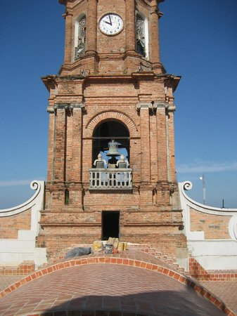 The Church of Our Lady of Guadalupe: Walking on the roof to the official door- to the next spiral staircase to get into the bell towe