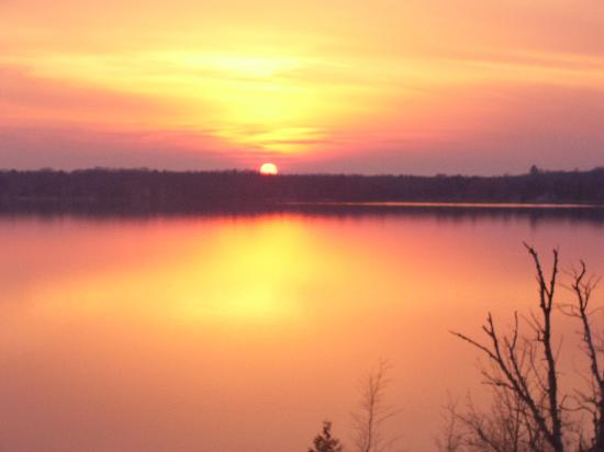 Torch Lake Bed & Breakfast: Spectacular sunsets taken from the deck of The Torch Lake B&B
