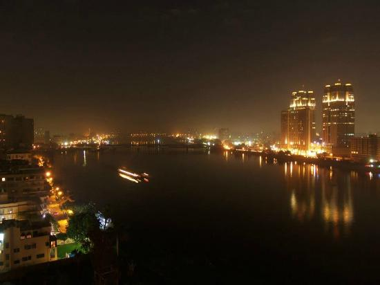 Hilton Cairo Zamalek Residences: View of the Nile at night from our balcony.