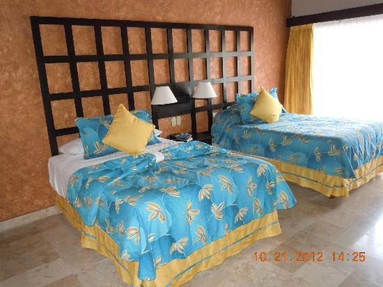 Villa del Palmar Beach Resort & Spa: My room.  Beautiful, and patio deck with table and chairs. The second bedroom had a queen or kin