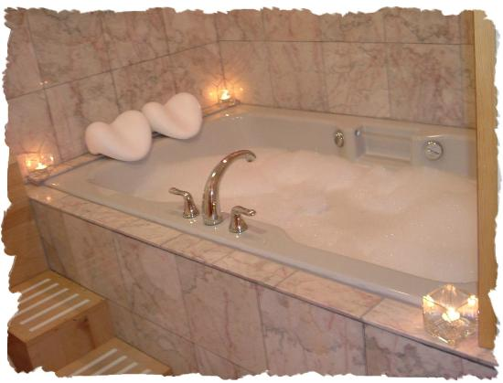 Escape for Two Bed & Breakfast: Relax in your oversize jetted tub for two in the Moose Cabin