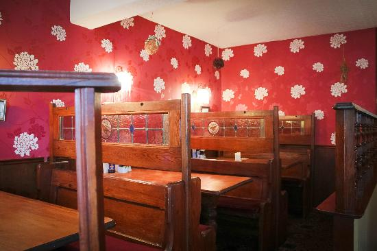 Victoria Hotel: Antique wooden church pews adapted into bar side dining area.