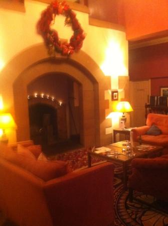 Crabwall Manor Hotel & Spa: large fireplace in lounge