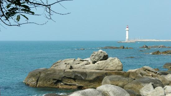 Sanya Daxiaodongtian Area: A man sun tanning on a rock