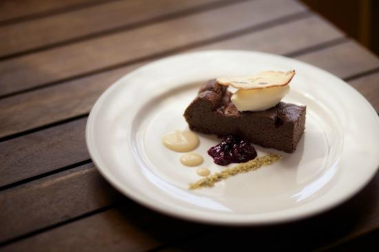 Bella Cafe Restaurant & Pizza Bar : Flourless Chocolate Torte, Berry Kissel, Frangelico Anglaise & Biscotti