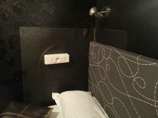 Hotel Pointe Rivoli: patch up wallcovering & dangerous to have power point near u when u sleep
