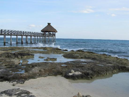 Mayan Palace Riviera Maya: Very Rocky Beach with beautiful pier. Bring water shoes! Not Great for Children at all!