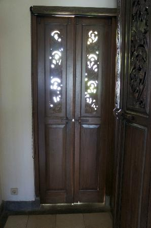 The Damai : French doors to private garden that provide no seal from mosquitoes