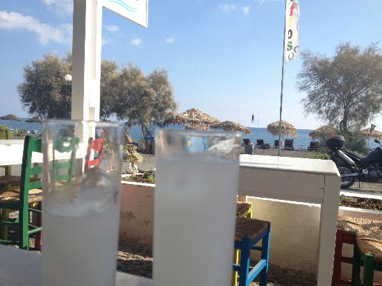 Afros: Ouzo on the beach with fresh octopus hanging in the background