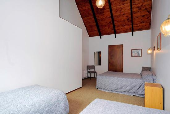 Midway Motel: large upstairs bedroom one double and two single beds