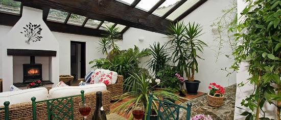 Garden room with dining area under glass roof picture of for Garden room reviews