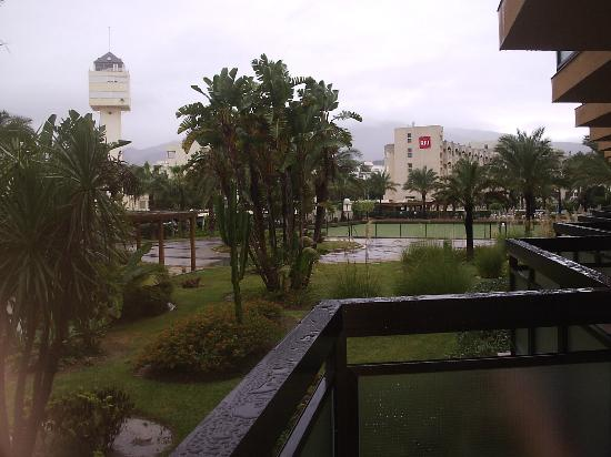 ClubHotel Riu Costa del Sol: View from ground floor room to Luca Costa Lago Hotel, raining again