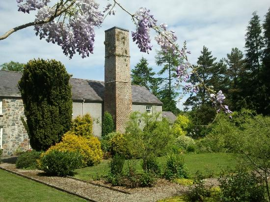Newforge House: Old linen mill chimney from garden