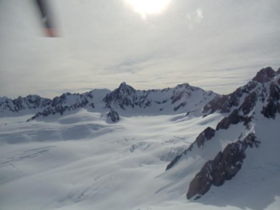 Misty Peaks: Heliride to Fox Glacier