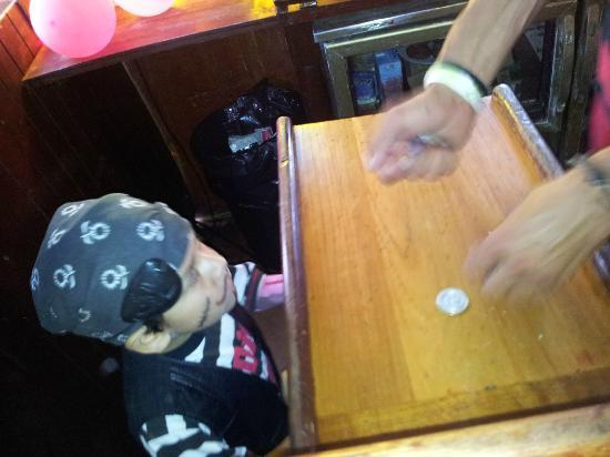 Jolly Roger Pirate Boat : Captain cashing in on the gold coins found in treasure hunt