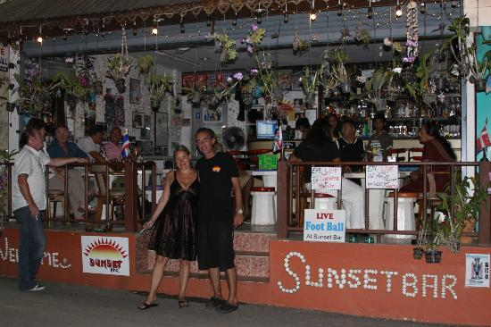 Sunset Bar: wife with Russell, top landlord, top guy.