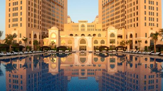 The St. Regis Doha: Olympic size swimming pool at Sunset