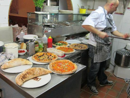 Da Vinci Restaurant: Making a few of our hand made pizzas