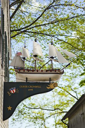 "Griswold Inn: Oliver Cromwell Replica Mounted on ""Family Cottage"" in Griswold Square"