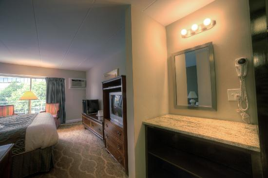 Don't fight over the bathroom mirror anymore--stay in a deluxe room at Americana Hotel!