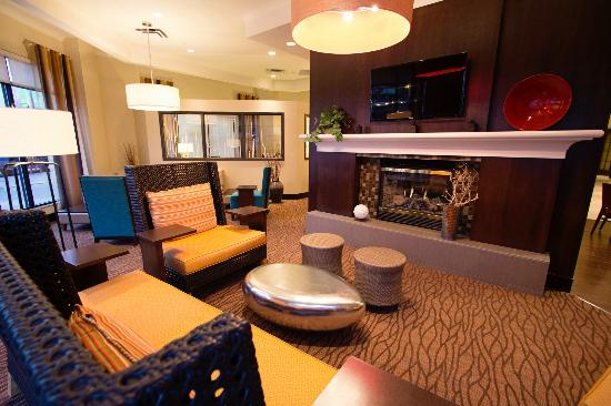 Hilton Garden Inn Saskatoon Downtown: Seating Area, Garden Cafe, We Proudly Serve Starbucks