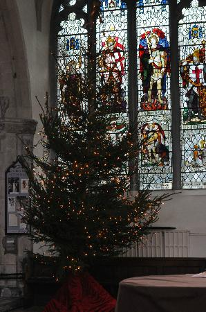 The Parish Church of St Thomas and St Edmund: Stained glass window and Christmas tree