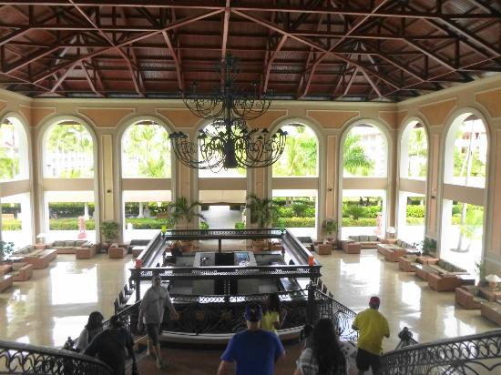 Majestic Colonial Punta Cana: Stairway view of the first floor Lobby Bar