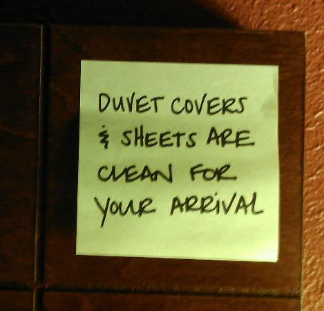 Stay Suites of America - Crestview, Florida: post it note on bed