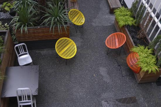 The Burrard: Colourful courtyard chairs
