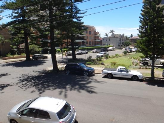 Manly Oceanside Accommodation: View from the balcony...the beach is just down that road