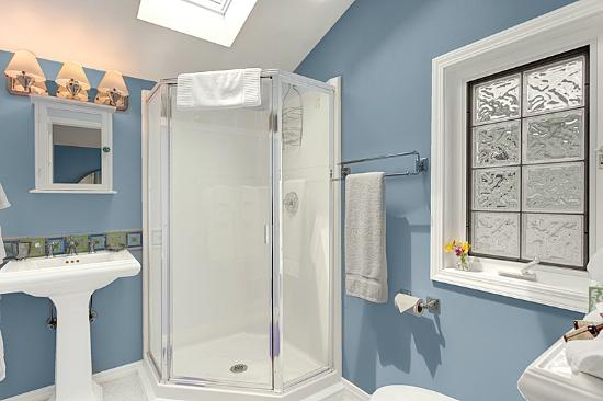 Boreas Bed and Breakfast Inn: The Hideaway bathroom with skylights and glass block accents.