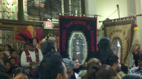 Cathedral Santuario de Guadalupe: Mayan costumed dancers carry banners and dance to honor the Virgen on her feast day Dec. 12