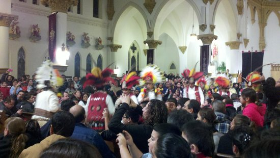 Cathedral Santuario de Guadalupe: Mayan costumed dancers lead the way into Mass on la Virgen's feast day, Dec. 12, 2012