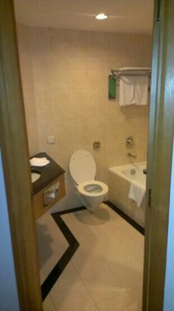 Furama City Centre: bathroom, bath and separate shower behind the door, perfect