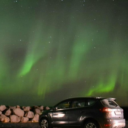 Keflavik, Iceland: Northern Lights at the lighthouse near Gardur