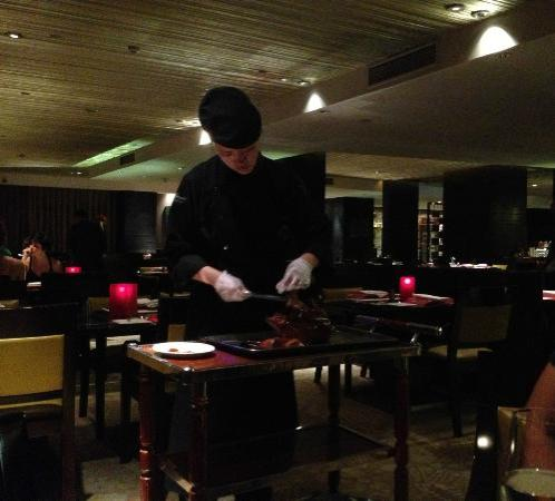Fairmont Beijing: at one of their restaurants, the waitress cutting our peking duck