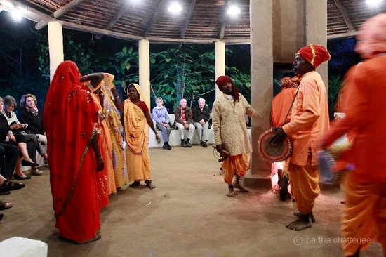 Tala, India: Tribal dance around log fire