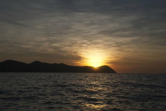 Mangenguey Island: Paddled out on the banca to enjoy the sunset