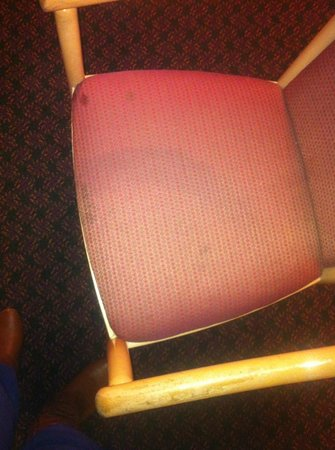 Howard Johnson Torrance: Stained, dirty chair #1.
