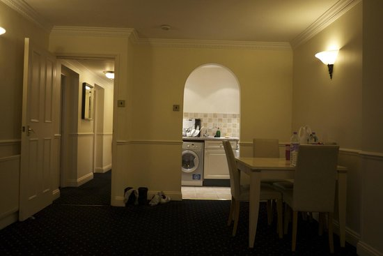 Collingham Serviced Apartments: view from living room to dining room and kitchen and the corridor