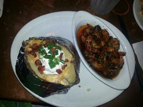 Court Street Cafe: barbecue shrimp with jumbo baked potato. Generous amount of shrimp!