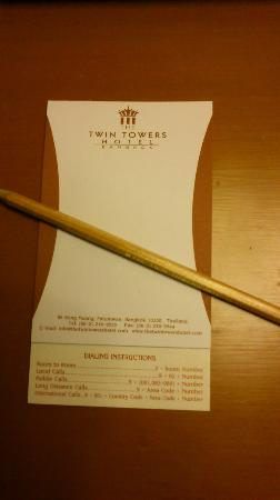 The Twin Towers Hotel: Note pad on bedside table