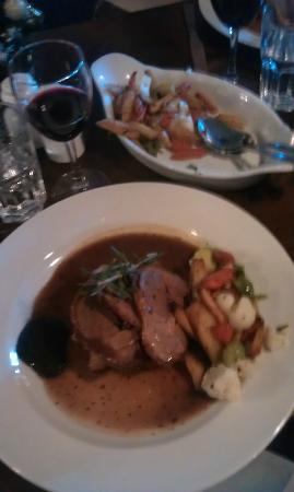 The Winning Hand : Roast lamb main course, with dish of vegetables.