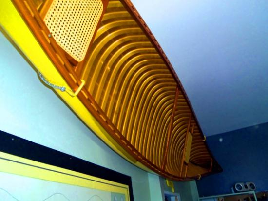 Yellow Canoe Cafe: The Iconic Yellow Canoe hanging on the wall.