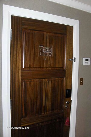 Forty 1⁰ North: I like a real solid door. Our room had a classy, varnished door along with the red tassle.