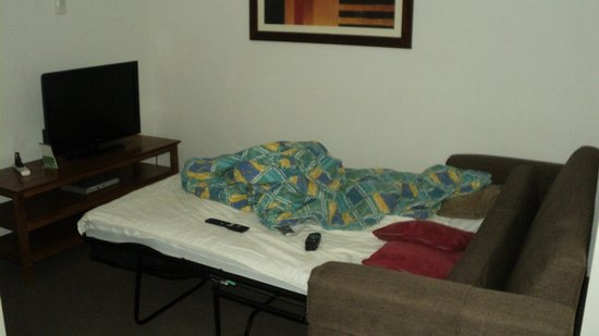 Karana Palms Resort: Fold-out-bed from couch.