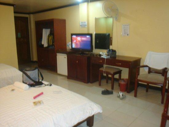 Boracay Peninsula Resort: open closet beside the fridge