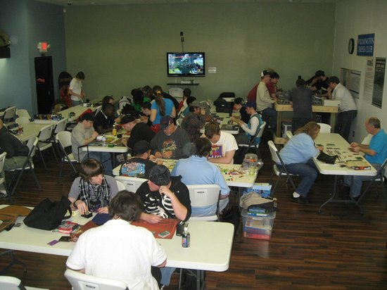 Cape Fear Games: Customers playing various tabletop games in the free play space